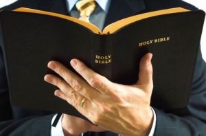 Bible in Man's Hand