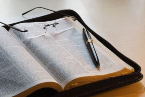 Bible - glasses and pen